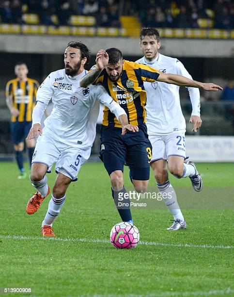 Eros Pisano of Hellas Verona competes with Mattia Cassani of UC Sampdoria during the Serie A match between Hellas Verona FC and UC Sampdoria at...