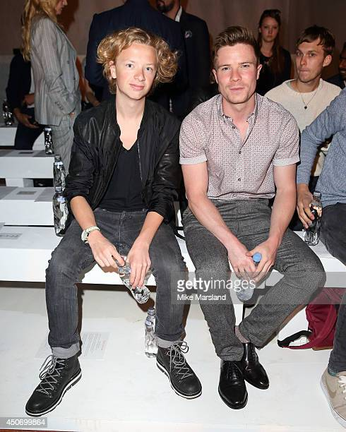 Eros Vlahos and Joe Dempsie attend the Oliver Spencer show during the London Collections Men SS15 on June 16 2014 in London England