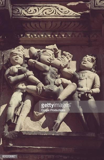Erotic foursome relief on Konark temple exterior