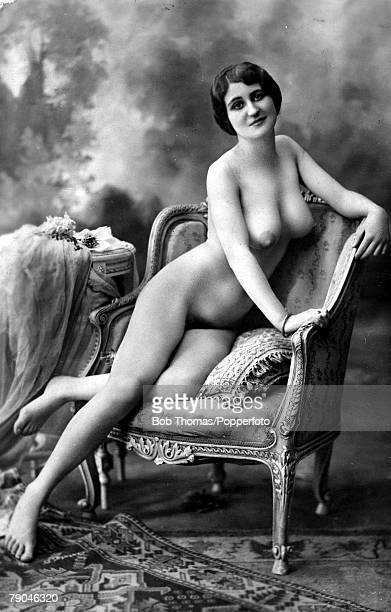 Erotic Postcard circa 1915 Nude Naked dark haired woman kneeling on an ornate chair full frontal