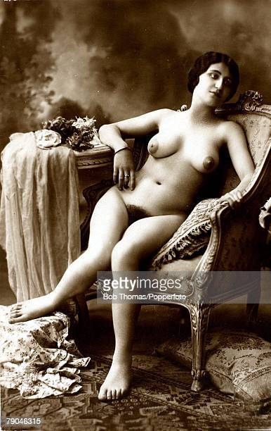 Erotic Postcard circa 1915 Nude Naked dark haired woman reclining in an ornate chair full frontal