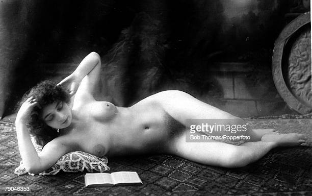 Erotic Postcard circa 1915 Nude Naked woman full frontal reclining on a carpet reading a book