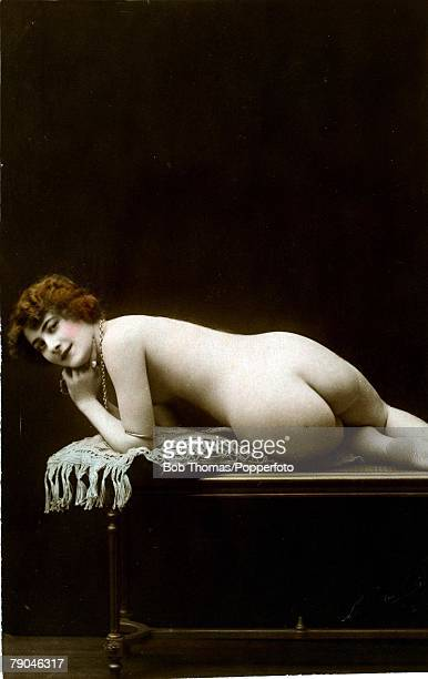 Erotic Postcard circa 1915 Nude Naked woman on a table her back and bottom facing the camera