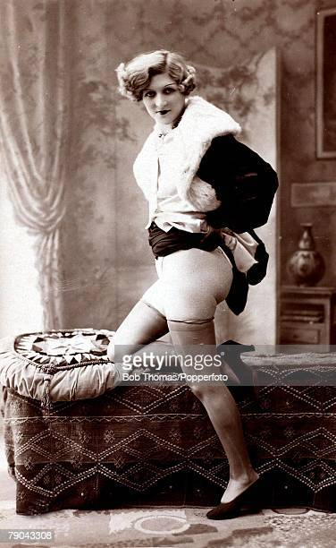 Erotic Postcard circa 1920 Dishabille Blond haired woman her dress raised to show her thighs and bottom