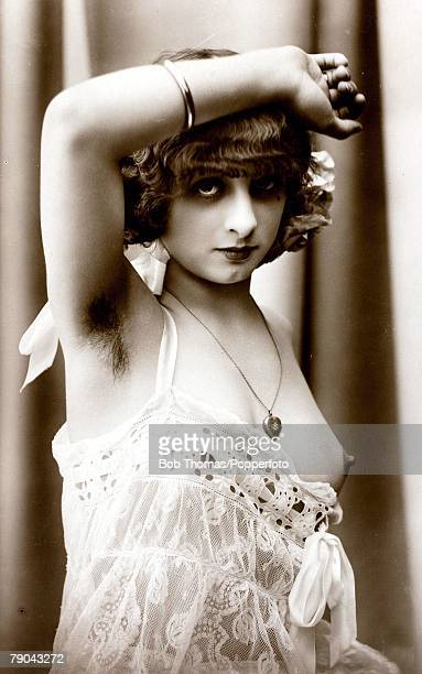 Erotic Postcard circa 1920 Dishabille Young dark haired woman wearing lacy negligee right hand on her headexposing armpit hair