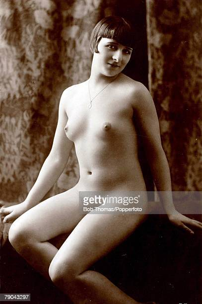 Erotic Postcard circa 1920 Nude Naked woman sitting full frontal looking at the camera