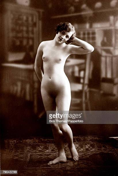 Erotic Postcard circa 1920 Nude Naked woman standing full frontal with her left hand behind her head
