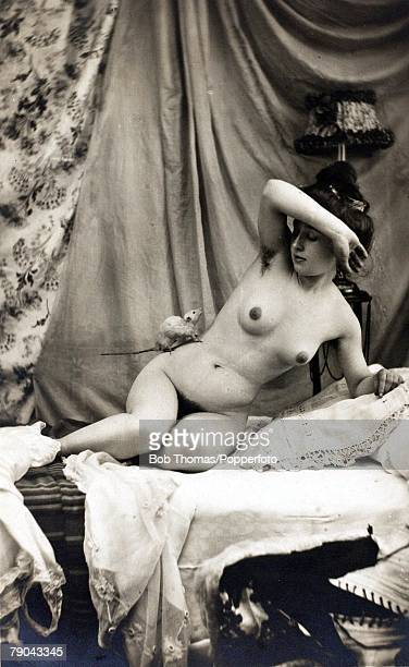 Erotic Postcard circa 1920 Nudes Naked woman dark hair with a white rat running on her body as she appears frightened
