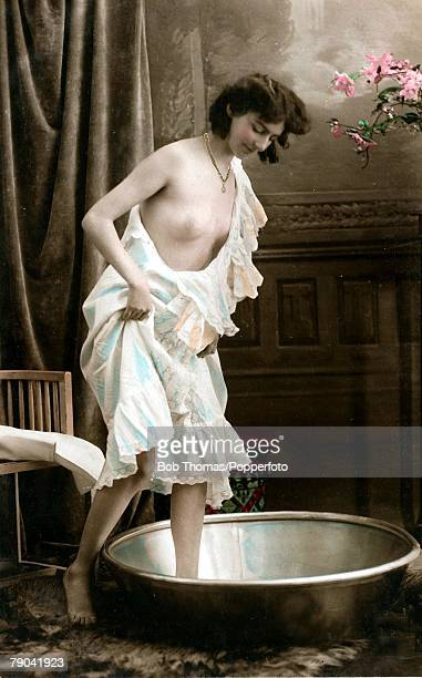 Erotic Postcard France circa 1920 Dishabille Young dark haired woman prepares to bathe in her bedroom