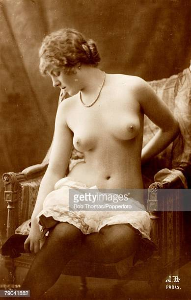 Erotic Postcard France circa 1920 Dishabille Young woman posing on a chair