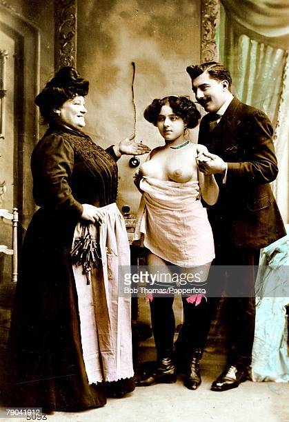 Erotic Postcard France circa 1920 Young dark haired woman and madame with a man who the girl will entertain in a brothel