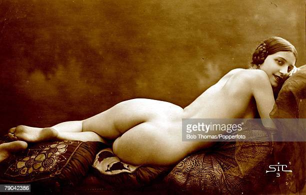 Erotic Postcards Circa 1915 A picture of a nude woman lying with her back towards the camera