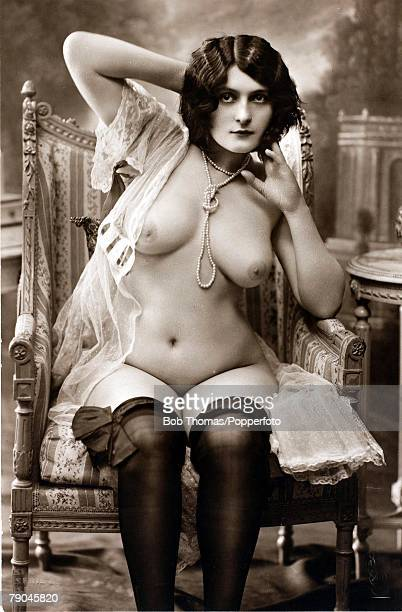 Erotic Postcards Circa 1915 Dishabille Dark haired woman naked save for a string of pearls necklace stockings and flimsy top open to expose her large...