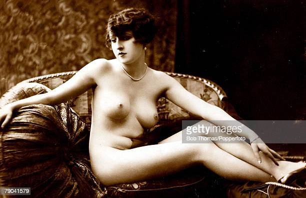 Erotic Postcards Circa 1920 A picture of a naked woman sitting on a couch