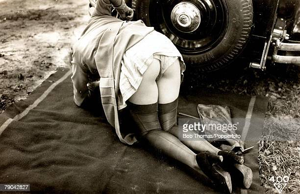 Erotic Postcards Circa 1920 Dishabille A picture of a woman revealing her lower half and knickers whilst working on a car