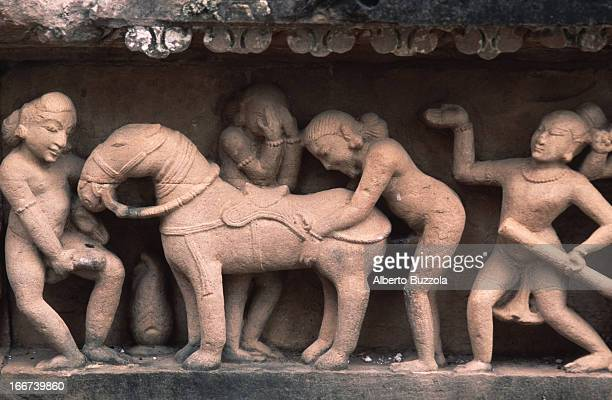Erotic sculpture at Lakshmana Temple shows men having sexual relations with a mare