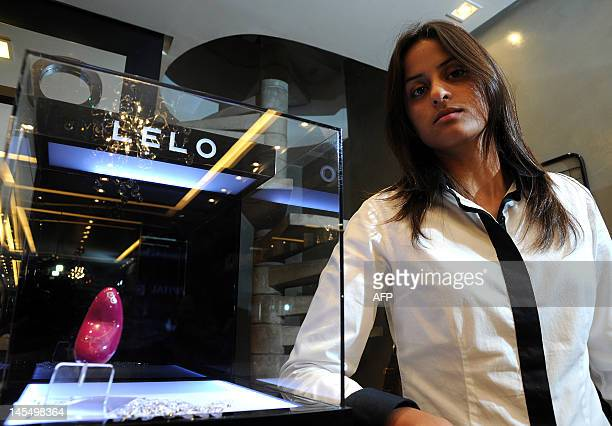 Erotika Luxo sex shop owner Ana Lucia Teixeira pictured at her store in Brasilia on May 31 2012 A goldplated vibrator worth 8000 real that was robbed...