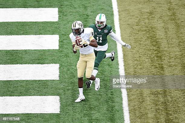 D'erren Wilson of the UCF Knights catches a pass for a touchdown in front of Dedrick Shy of the Tulane Green Wave during the fourth quarter of a game...