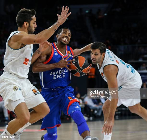 Errick Mccollum of Anadolu Efes in action against Facundo Campazzo of Real Madrid during the Turkish Airlines Euroleague basketball match between...
