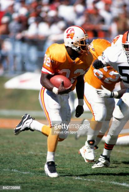Errict Rhett of the Tampa Bay Buccaneers carries the ball against the Cleveland Browns during an NFL football game September 10 1995 at Cleveland...