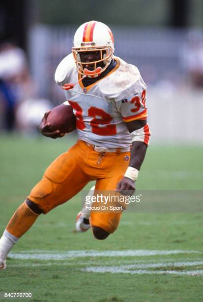 Errict Rhett of the Tampa Bay Buccaneers carries the ball against the Cincinnati Bengals during an NFL football game circa October 8 1995 at Tampa...