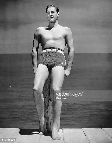 Errol Flynn famous for his swashbuckling film roles of the 1930's 1940's and 1950's poses in his bathing suit