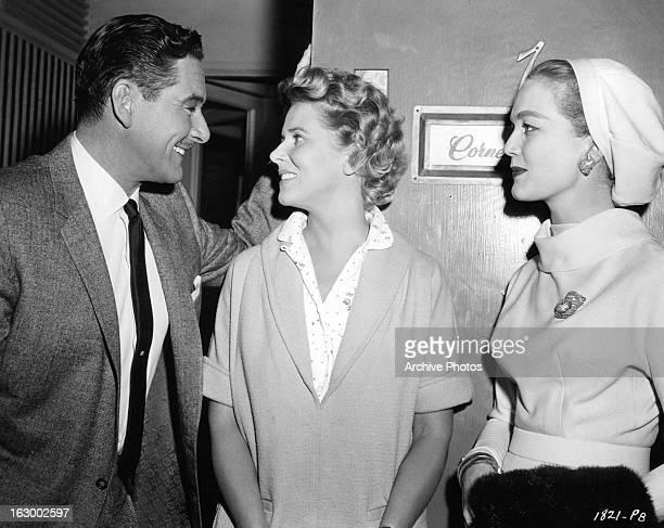 Errol Flynn greets Cornell Borchers on the set of the film 'Istanbul', 1957.