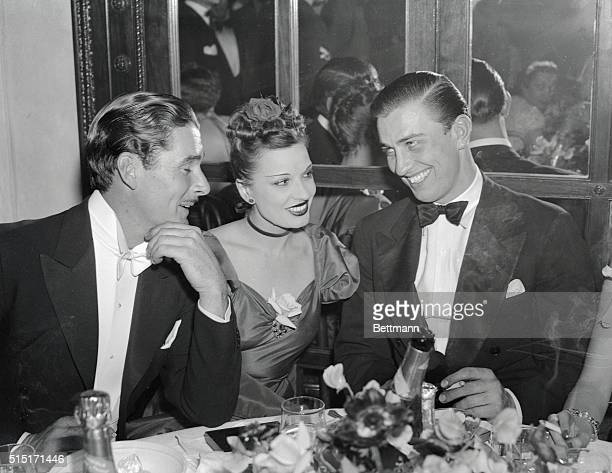 Errol Flynn his wife Lily Damita and Franklin D Roosevelt Jr as they attended the Gold Plate Breakfast at the Carlton Hotel held in connection with...