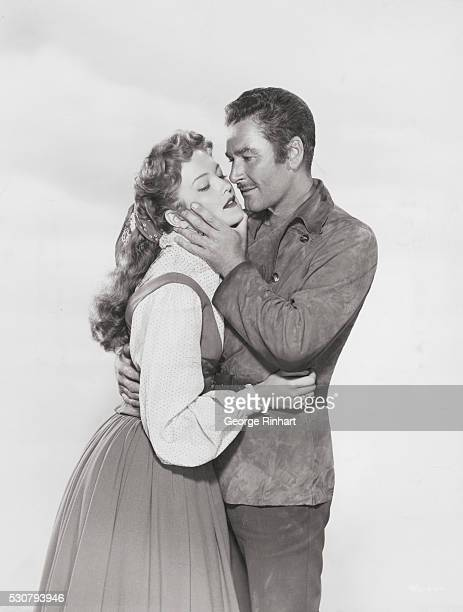 Errol Flynn makes love to his wife Pat Wymore in the WB film Rocky Mountain