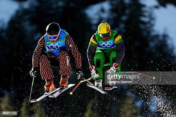 Errol Kerr of Jamaica and Davey Barr of Canada compete in a men's ski cross race on day ten of the Vancouver 2010 Winter Olympics at Cypress Mountain...