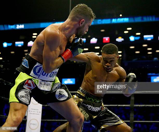 Errol Spence Jr and Chris Algieri exchange punches during their welterwieght bout at Barclays Center on April 16 2016 in the Brooklyn borough of New...