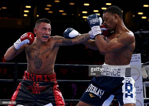 Errol Spence Jr and Samuel Vargas exchange punches during the Premier Boxing Champions bout at Barclays Center on April 11, 2015 in the Brooklyn...