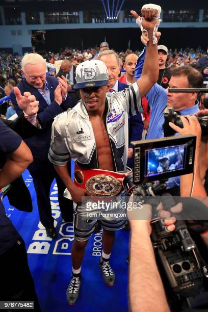 Errol Spence Jr celebrates after knocking out Carlos Ocampo in the first round of a IBF Welterweight Championship bout at The Ford Center at The Star...