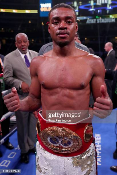 Errol Spence Jr celebrates in the ring after defeating Mikey Garcia in an IBF World Welterweight Championship bout at AT&T Stadium on March 16, 2019...