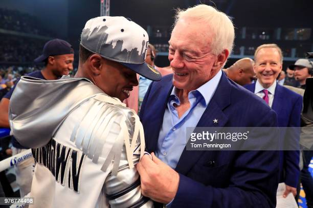 Errol Spence Jr celebrates with Dallas Cowboys owner Jerry Jones after knocking out Carlos Ocampo in the first round of a IBF Welterweight...