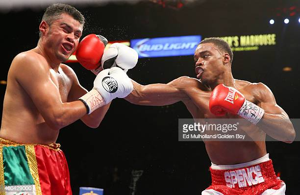 Errol Spence Jr. Hits Javier Castro during their junior middleweight fight at the MGM Grand Garden Arena on December 13, 2014 in Las Vegas, Nevada.