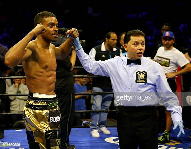 Errol Spence Jr is declared the winner by knock out in the fifth round as the referee stopped the fight against Chris Algieri during their...