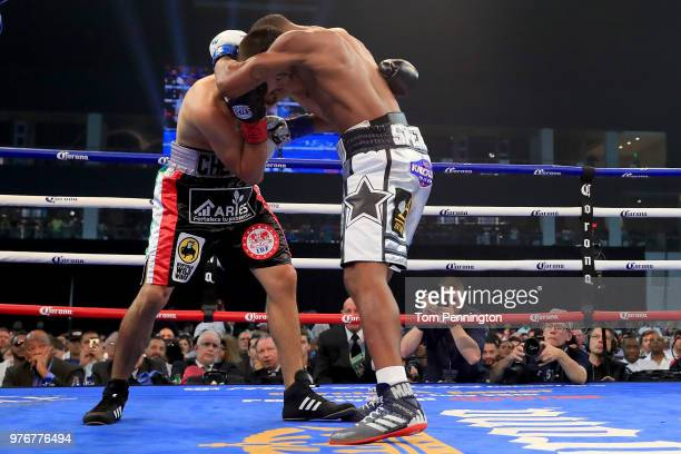 Errol Spence Jr lands a body shot on Carlos Ocampo in the first round of a IBF Welterweight Championship bout at The Ford Center at The Star on June...