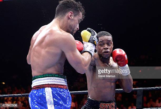 Errol Spence Jr punches at Phil Lo Greco during their welterweight bout at MGM Grand Garden Arena on June 20 2015 in Las Vegas Nevada Spence won the...