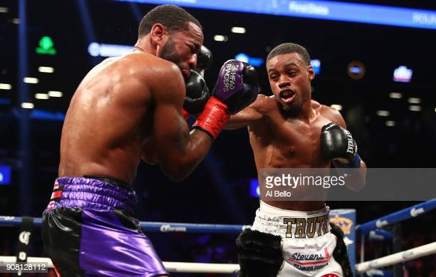 Errol Spence punches Lamont Peterson during their IBF Welterweight title fight at the Barclays Center on January 20 2018 in New York City