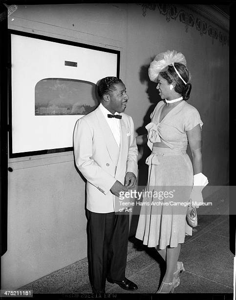 Erroll Garner and Ethel Ramos Harris standing in hallway of Syria Mosque for Night of Stars Pittsburgh Pennsylvania August 1947