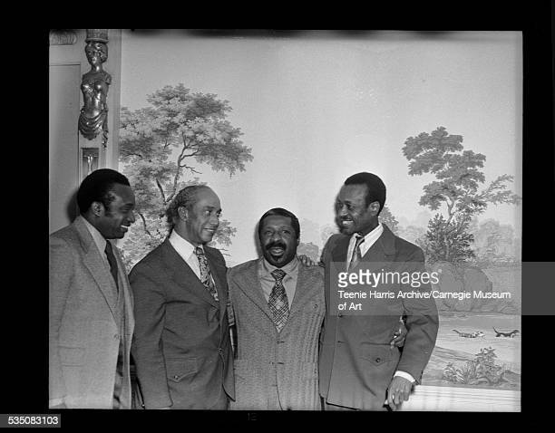 Erroll Garner standing with Walt Harper and two men with painting or mural of landscape in background Pittsburgh Pennsylvania 1971