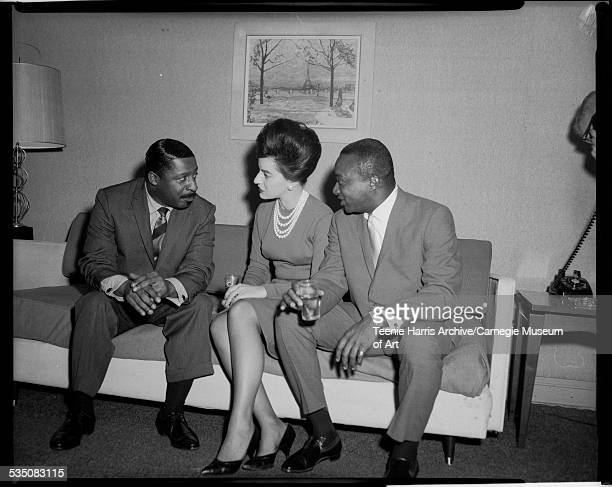 Erroll Garner talking to woman with upswept hairstyle and Walt Harper in Penn Sheraton Hotel Pittsburgh Pennsylvania September 1962