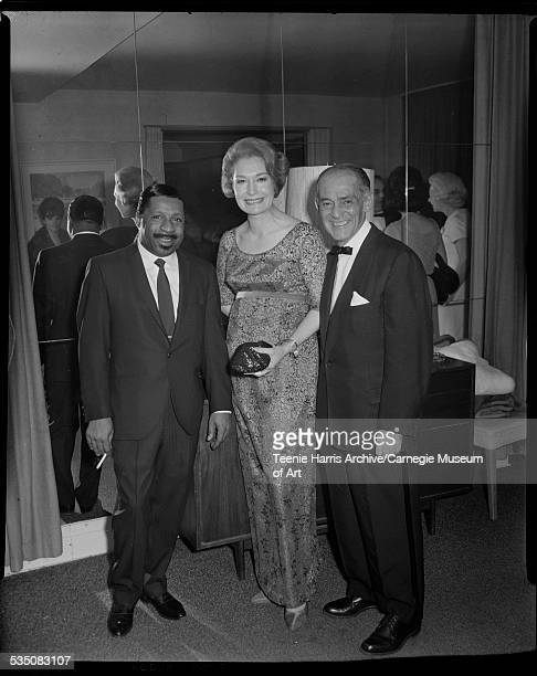 Erroll Garner woman wearing gown and man wearing tuxedo posed in front of mirrored wall reflecting other people in the room Pittsburgh Pennsylvania...