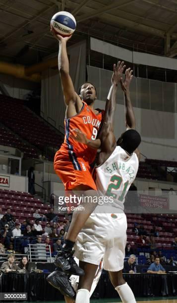 Erron Maxey of Columbus RiverDragons scores against Karim Shabazz of the Charleston Lowgators at the North Charleston Civic Center February 20, 2004...