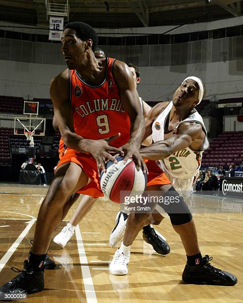 Erron Maxey of Columbus RiverDragons spins while Jason Miskiri of the Charleston Lowgators goes for the steal at the North Charleston Civic Center...