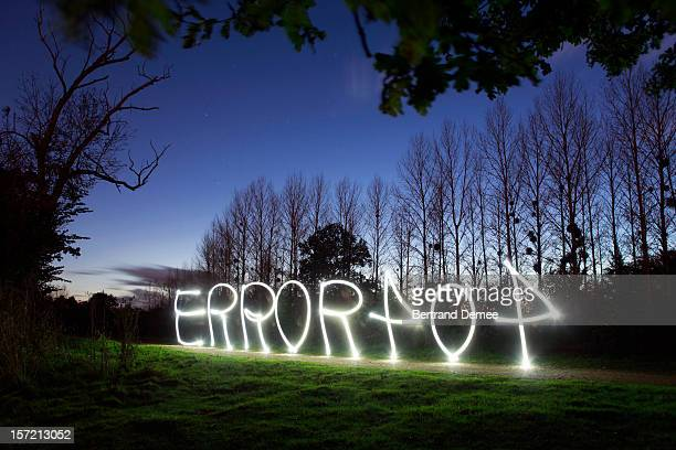 'Error 404' message in light, in a rural setting