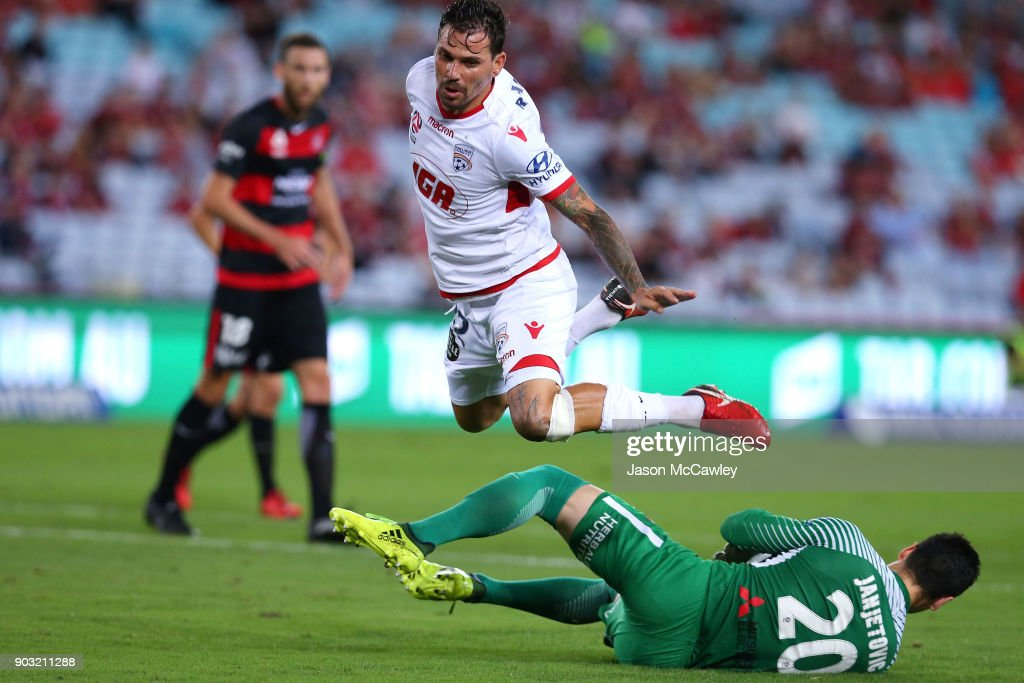 Ersan Gulum of Adelaide and Vedran Janjetovic of the Wanderers compete for the ball during the round 15 A-League match between the Western Sydney Wanderers and Adelaide United at ANZ Stadium on January 10, 2018 in Sydney, Australia.