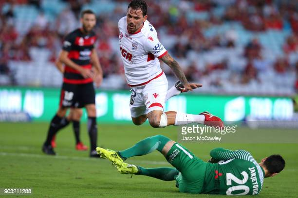 Ersan Gulum of Adelaide and Vedran Janjetovic of the Wanderers compete for the ball during the round 15 ALeague match between the Western Sydney...