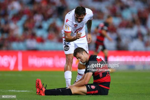 Ersan Gulum of Adelaide gestures to Oriol Riera of the Wanderers during the round 15 ALeague match between the Western Sydney Wanderers and Adelaide...